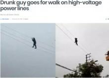 【海外発!Breaking News】高圧線の上を綱渡りする酔っ払い男、消防署員に救助される(中国)