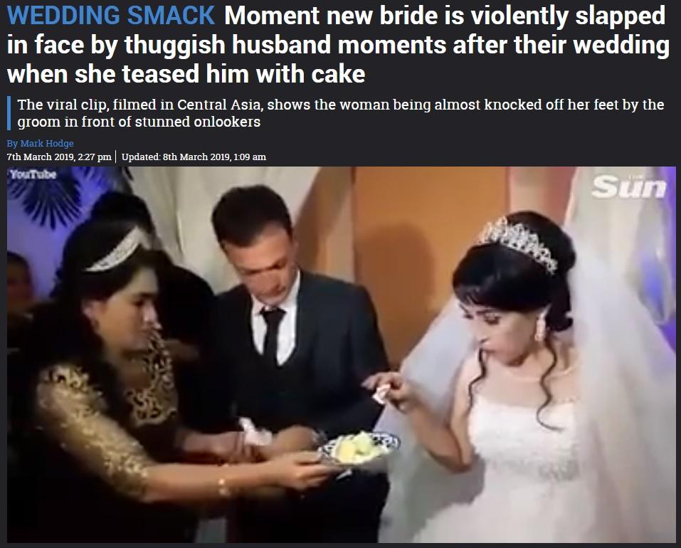 ケーキを手にした花嫁、その後とんだ仕打ちに(画像は『The Sun 2019年3月8日付「WEDDING SMACK Moment new bride is violently slapped in face by thuggish husband moments after their wedding when she teased him with cake」』のスクリーンショット)